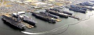 USS Dwight D. Eisenhower (CVN 69), USS George H.W. Bush (CVN 77), USS Enterprise (CVN 65), USS Harry S. Truman (CVN 75), and USS Abraham Lincoln (CVN 72) are in port at Naval Station Norfolk, Va., the world's largest naval station  Read more: http://www.businessinsider.com/the-worlds-largest-naval-station-is-packed-tight-for-christmas-2012-12#ixzz2PZuF6MHh